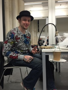 Adam created a swinging, stabilising cup and flute-like glass holder so wheelchair users can drink in social events with out being restricted in mobility.